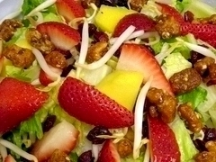 The 1132 Salad with strawberries, mango, glazed walnuts and cranberries on a bed of lettuce