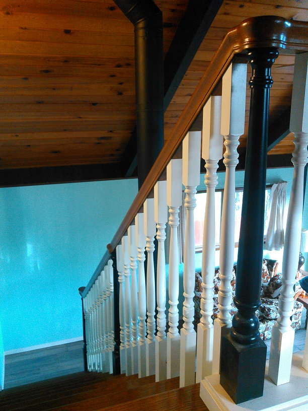 Grand stairway handrail that has black newel posts, cream spindles, and stain grade graspable top rail. It was a pleasure to build and it turned out to be a masterpiece.