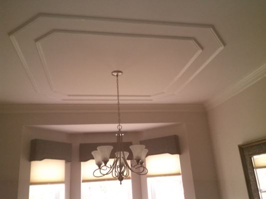 The homeowner was looking to achieve the look of a tray ceiling on a budget.