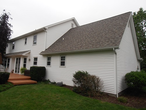 This homeowner in Warren OH called us because his shingles were dry and curling on his 14-15 year old roof, due to a ventilation issue. The previous contractor had installed turtle vents and gable vents, as well as having soffit. We installed a new Owens C