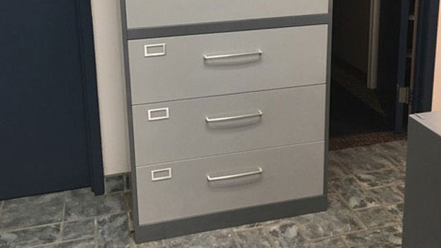On-site electrostatic painting (custom two-tone paint finish) of vertical and lateral metal filing cabinets