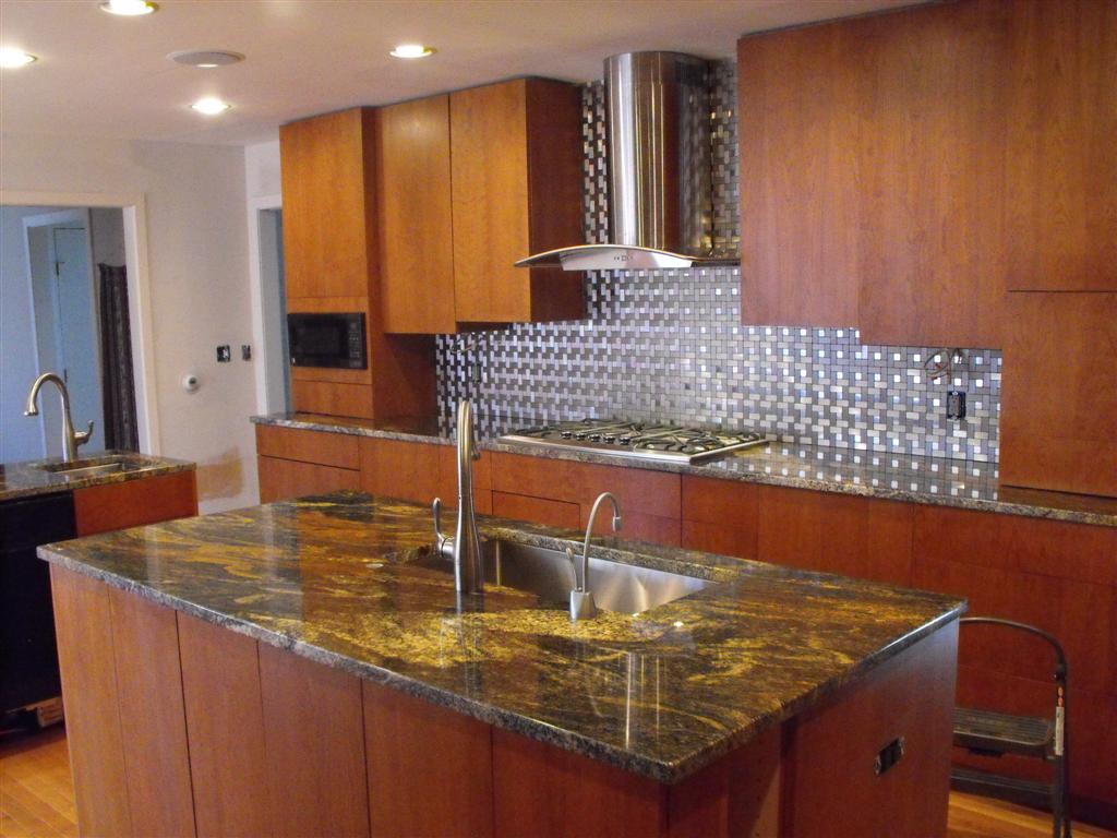 Stainless Backsplash, Granite Counters, Custom Cabinets and flooring