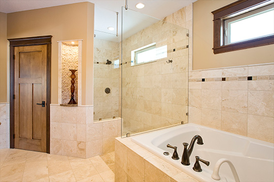 This bathroom remodel features  extensive use of Travertine tile.