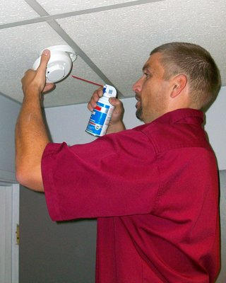 Allied Technician Cleaning Smoke Detector