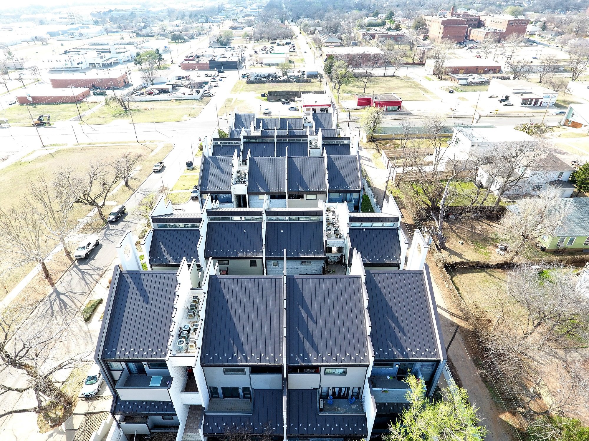 Standing seam metal roof replacement, gutters and downspouts, and exterior coatings on OKC Condominium complex.