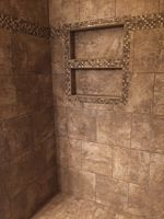 Shower with tile installation on broken joint pattern