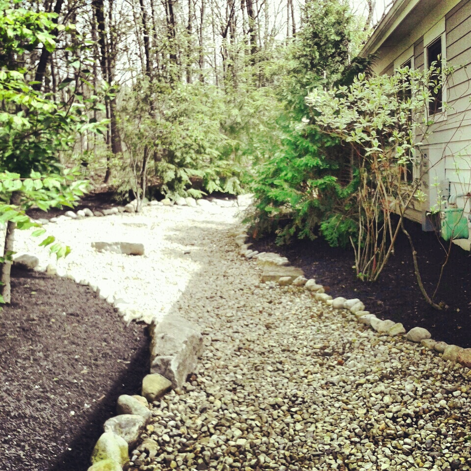 Re-construction and mulch installation of dry rock bed in Powell, Ohio.
