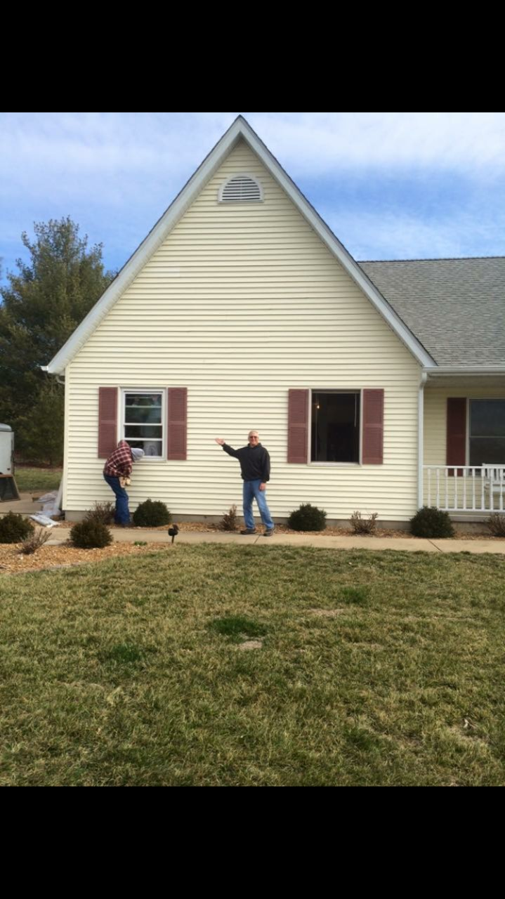 Happy homeowner with his new, energy efficient replacement windows.  We install many types of windows, double hung, single hung, picture, sliding, casement, bay, natural wood and many more with warranties.