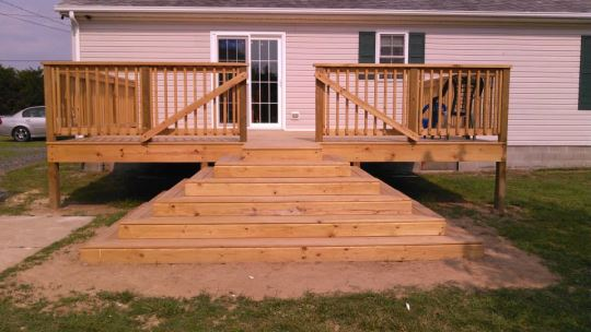 All treated deck with landing and wrap around steps