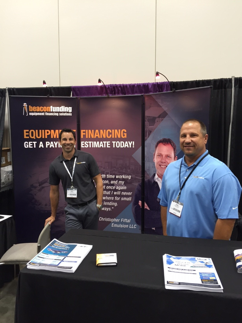 Two sales consultants at a tradeshow in our booth,
