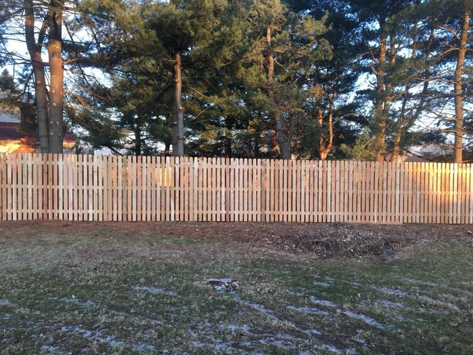 This is the exterior view of one of our recently installed western red cedar (1.5 in) spaced picket fence in Collegeville, PA.  Our wood fences are custom stick built one picket at a time with fully framed gates and 2in x 4in runners.