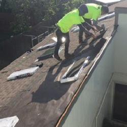 Crew working on complete re-roof