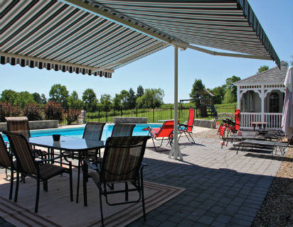 """A unique free-standing retractable Sunesta awning providing shade poolside."""