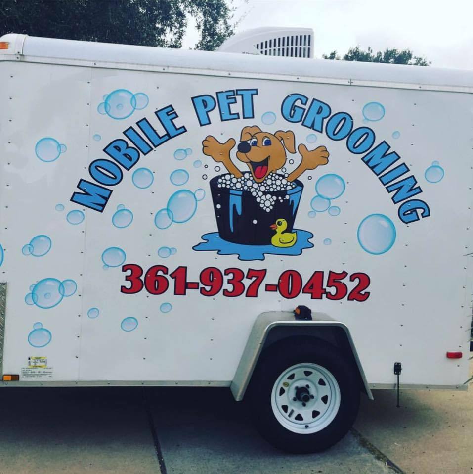 Grubby Paws Mobile Pet Grooming logo