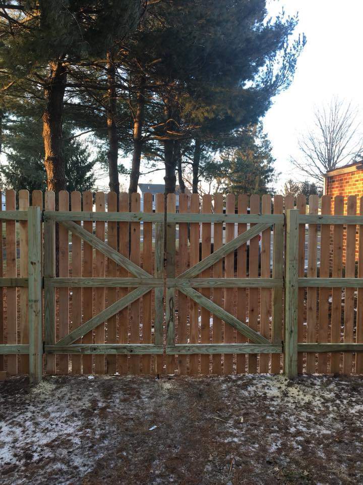 This is the interior view of one of our recently installed custom built 8' wide double drive gate for a western red cedar (1.5 in) spaced picket fence in Collegeville, PA.  Our wood fences are stick built one picket at a time with fully framed gates and 2i