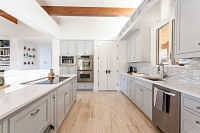 Newly purchased home needed updating to a modern look.   By modifying cabinets, adding new tile, extra lighting, bright paint and counter tops as well as sparkling up the existing flooring, we created a wonderful look that the owners loved.