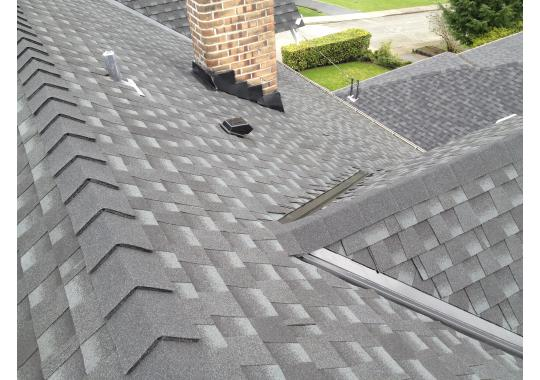 A complete new roof in New Westminster, using GAF Timberline Charcoal shingle new chimney base and counter flashing.