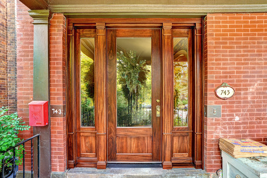 Mahogany front door featuring a chestnut stain that enhances the already beautiful grain of the wood. The crew also applied a clear urethane topcoat with UV protection especially formulated for exterior woodwork.