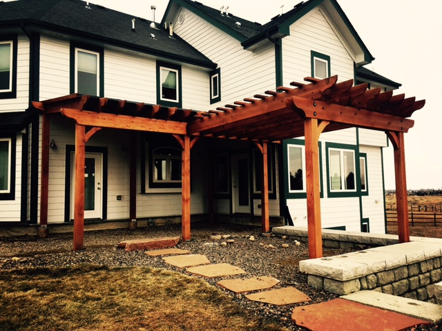 20x12 cedar pergola style porch cover with a 10x12 cedar pergola attached to the front with a custom built in gutter system.