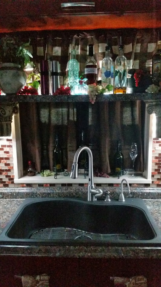 We updated this kitchen with A single bay sink and touch free faucet.