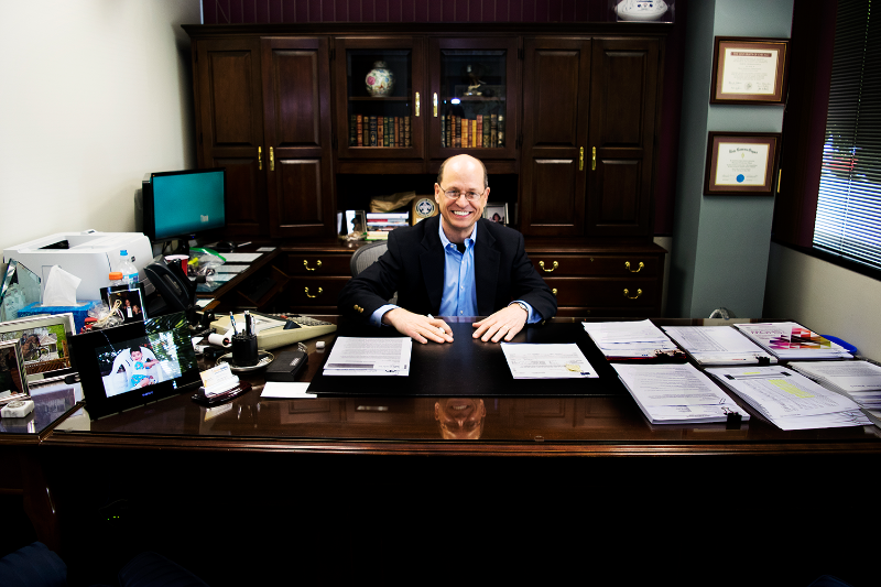 CEO of Beacon Funding at his desk