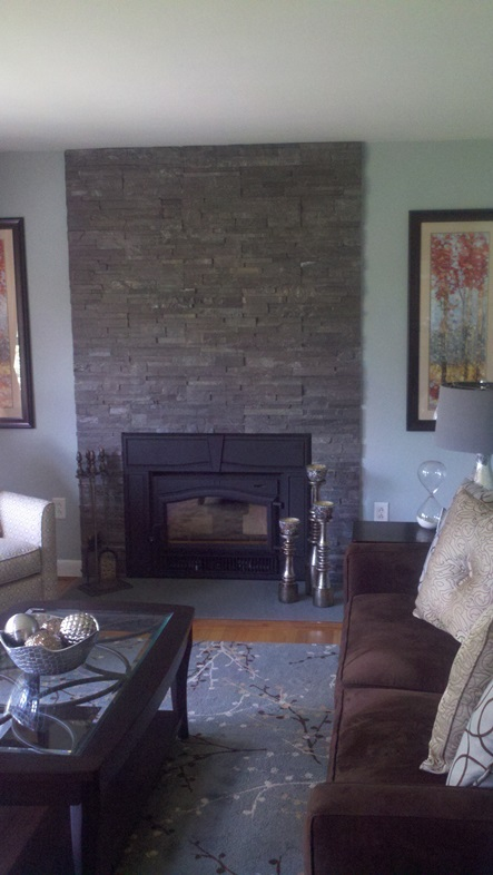 stone faced fireplace with blue stone hearth