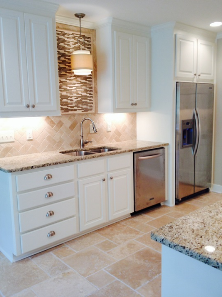 This client wanted to shift her kitchen from mean and green to light and bright! To see before and after images of this renovation and more, please visit us on the web: www.homeremediesllc.com.