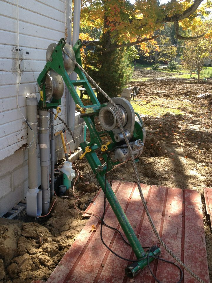 Peerless used this Greenlee Chugger assembly to pull in a new underground service feed to a residence from the road.