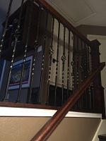 Installed iron railing on half wall