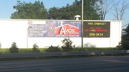 Amos Exteriors - specializing in roofing, siding, gutters, windows, and storm damage repair.