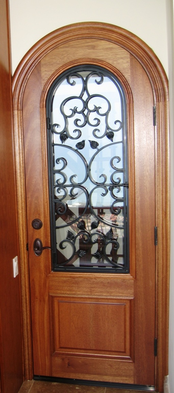 Wine room door with clear glass and operating iron - custom door project by Builders Direct Supply
