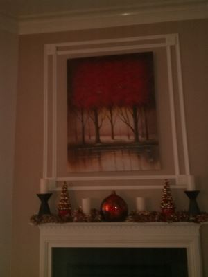 Trim over a mantle to accent around the homeowners picture.