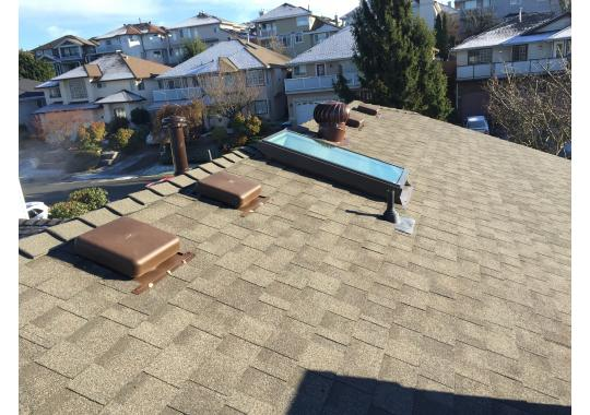 A complete new roof using GAF Timberline Shingles RT65 air vents and VELUX skylight.