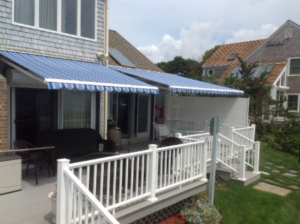 """Two awnings over a large deck on this oceanfront home in Harwich."""