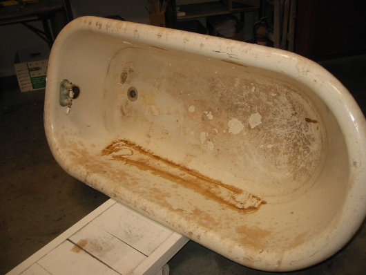 Todd's can make this rusty porcelain clawfoot tub look new by refinishing it in our shop!