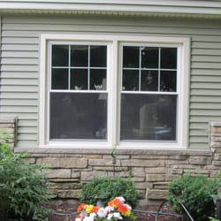 Sunrise twin double hung windows with culture stone knee wall in Naperville