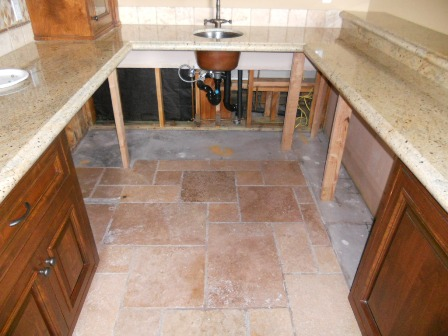 During mold remediation, cabinetry needed to be removed and replaced, but granite counter tops were able to be propped up and saved.