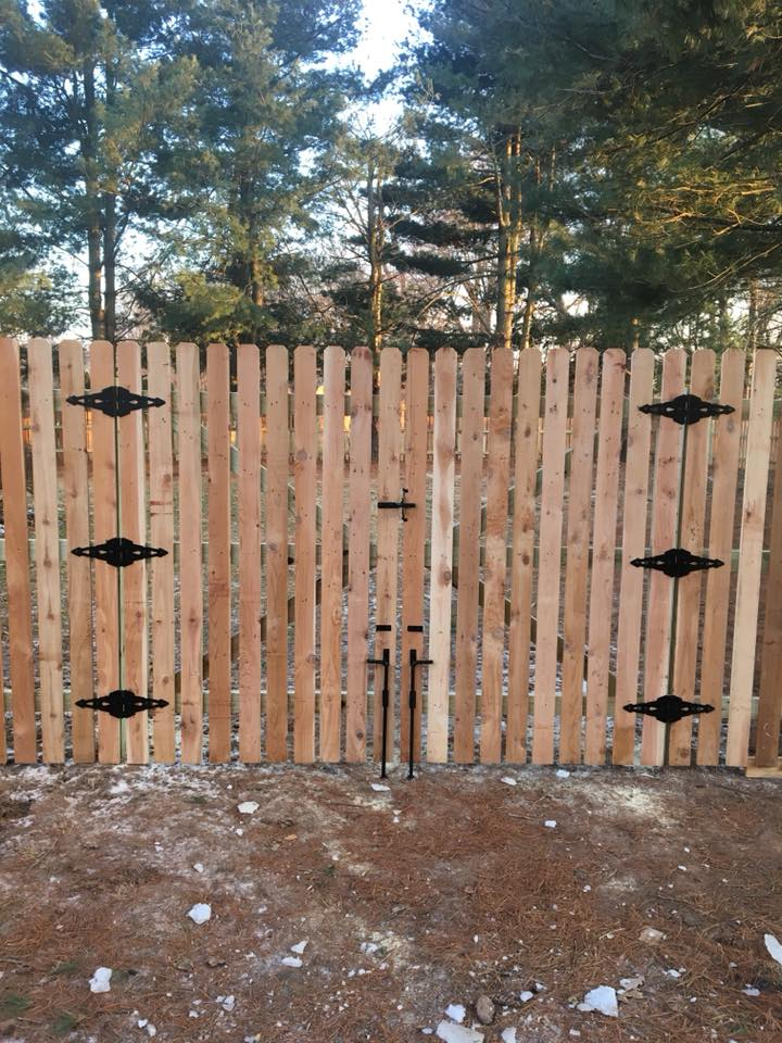 This is the exterior view of one of our recently installed custom built 8' wide double drive gate for a western red cedar (1.5 in) spaced picket fence in Collegeville, PA.  Our wood fences are stick built one picket at a time with fully framed gates and 2i