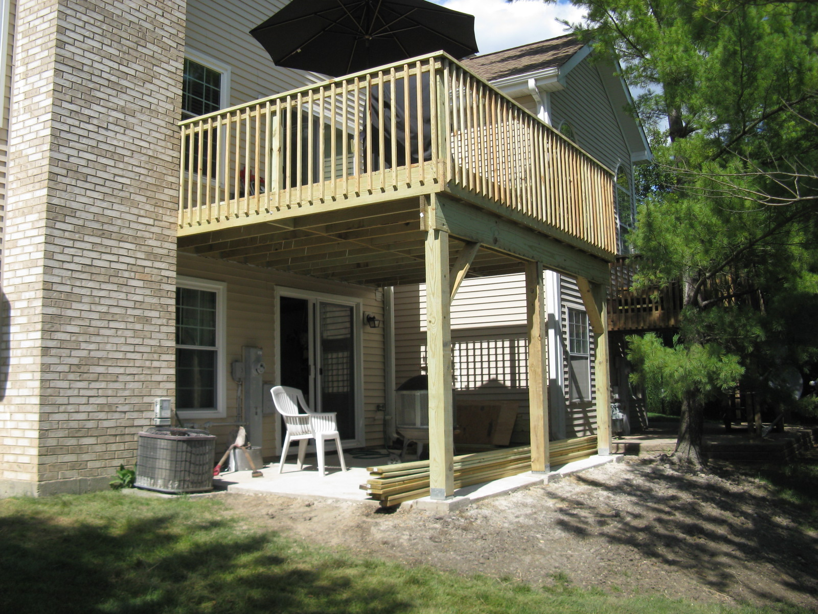 Two-story Deck in Hanover Park by Phoenix Home Construction.