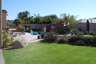 We created a complete backyard.  It includes a pool with a slide, grotto, in ground diving board, swim up bar, outdoor kitchen, landscaping, and sport court.