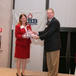 Marlene Herman receiving a Better Business Bureau Award honoring Businesses with Integrity.