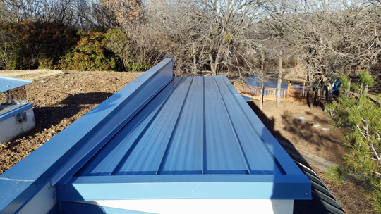Finished standing seam metal roof replacement.