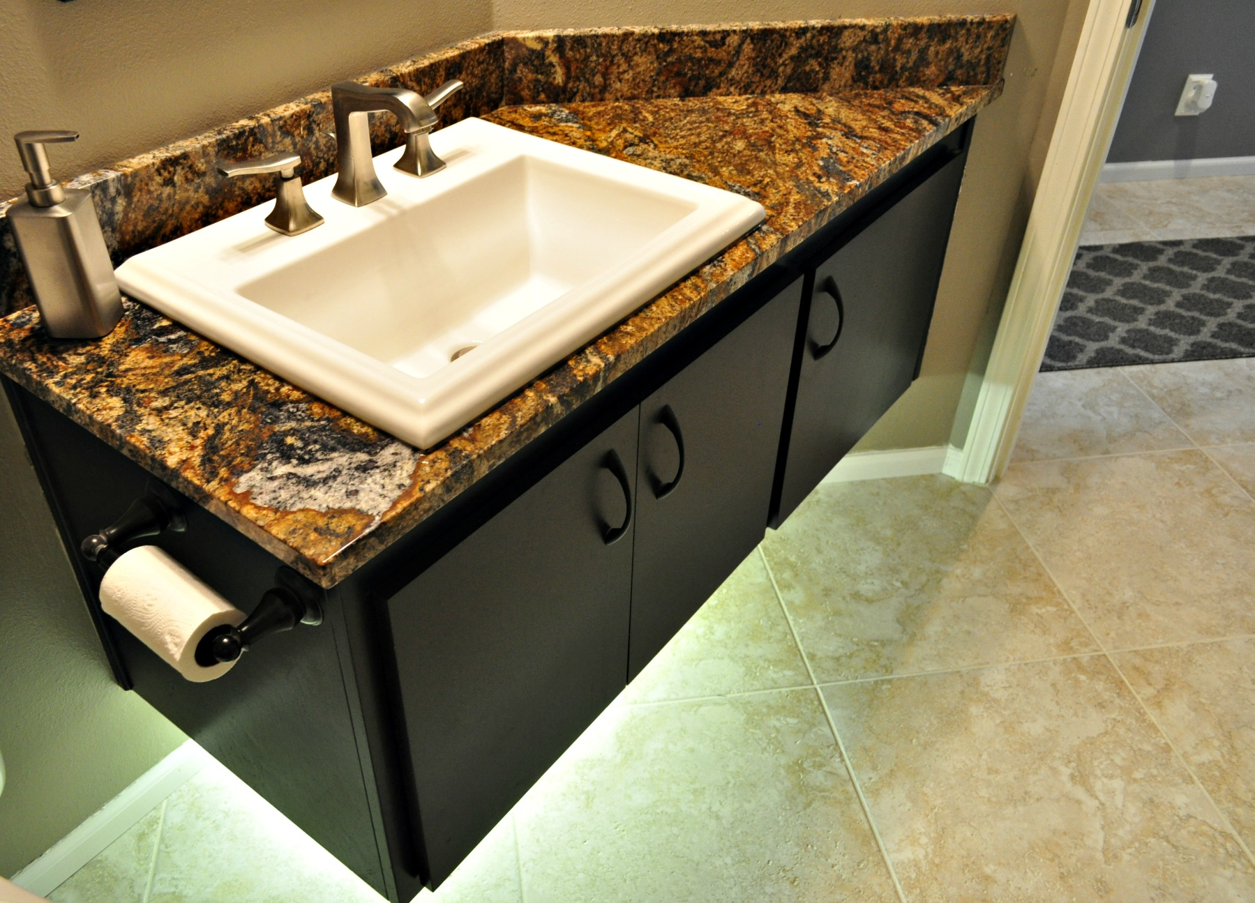 Just finished remodeling this half bath. What a stunning piece of granite!
