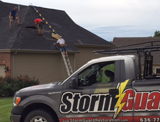 Emergency tarping after storm damage to roof