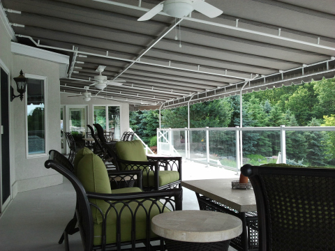 Grey Sunbrella fabric deck canopy featuring a white powder coated frame and ceiling fans