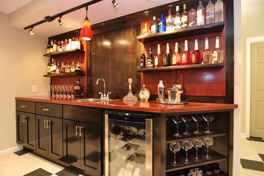 Custom built bar with maple and oak cabinetry
